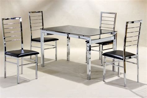 medium chrome glass dining table and 4 faux chairs in black