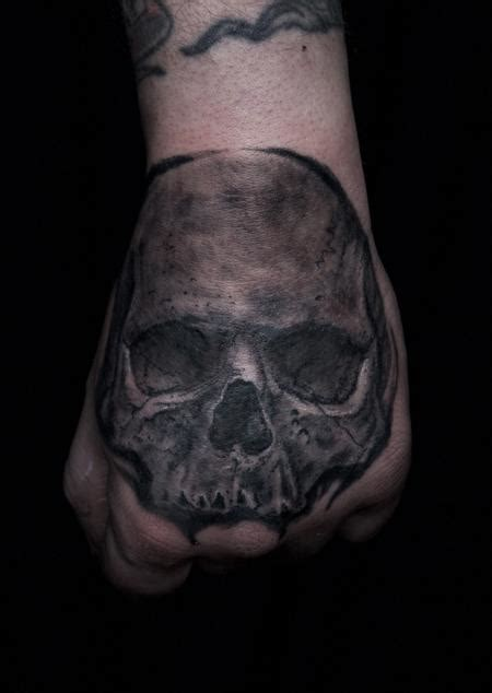 tattoo black and grey skull black and grey tattoo skull on hand by ben licata tattoonow