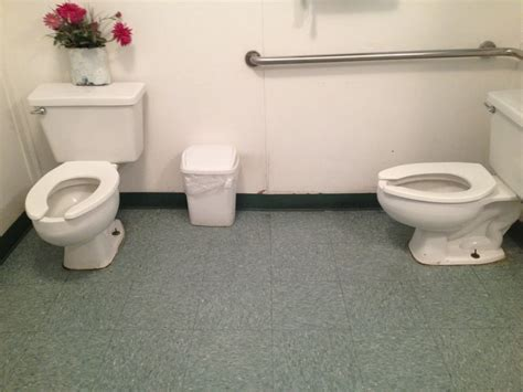 bathroom with two toilets women s bathroom two toilets but no stall walls good for