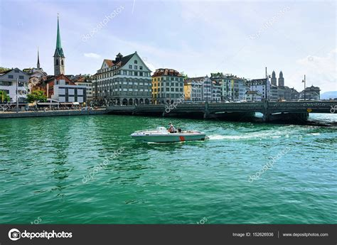 boat buy zurich fraumunster church and motor boat at limmat in zurich