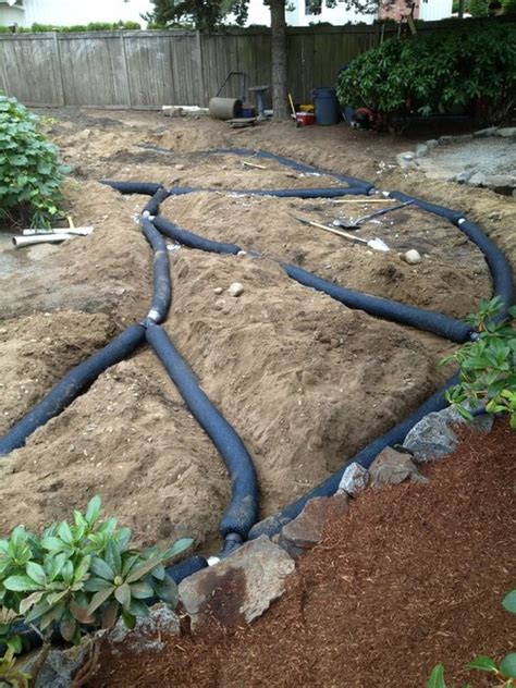 backyard drainage pipe french drain install yelp landscaping ideas