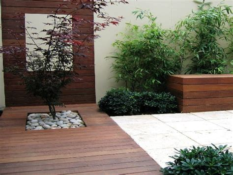 modern landscape design same from a different view point tree pebbles decking pavers garden