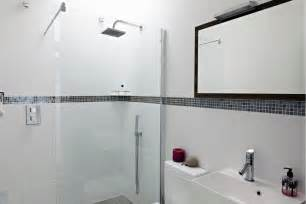 glass bathroom design house with floor to ceiling glass and beautiful nature views
