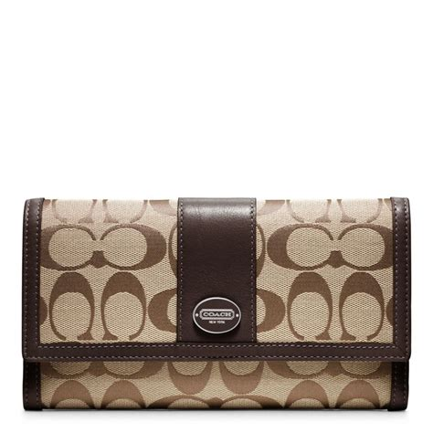 coach legacy signature checkbook wallet in brown lyst