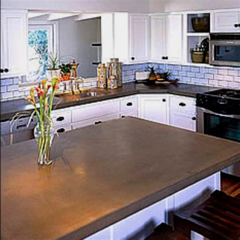kitchen white cabinets with concrete countertops