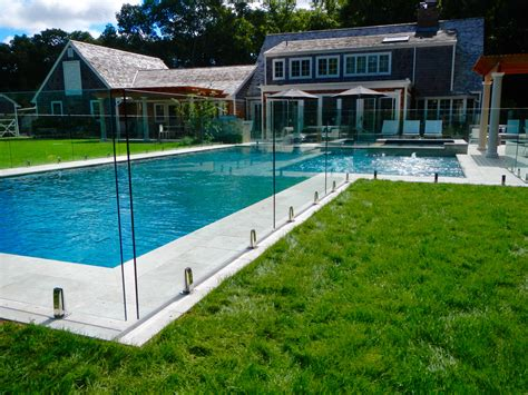 pros and cons of pool fences vs pool covers the pros and cons of frameless glass fencing us glass fence