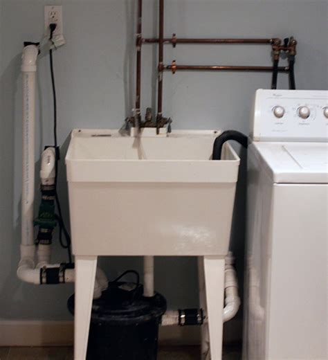 installing a utility in basement washing machine in basement pump up help the wall