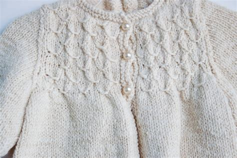 Handmade Knitting Designs - handknit smocked baby sweater in handspun merino wool