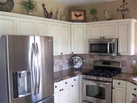 black stainless steel appliances with white cabinets