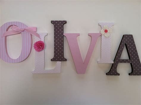 alphabet wooden letters for nursery in pink white and brown