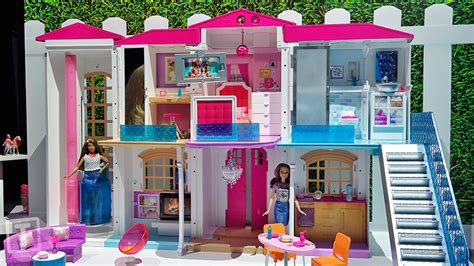 barbies dream house cue the doll dance party hello barbie s dream house is smart and voice activated