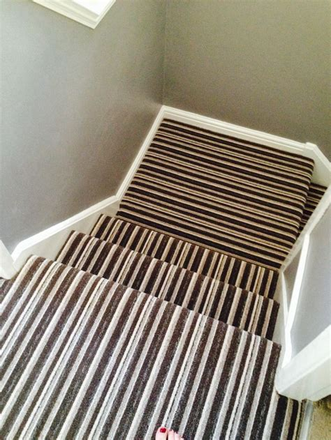 stair landing rug stripe landing and stair carpet ideas carpets stairs and stripes