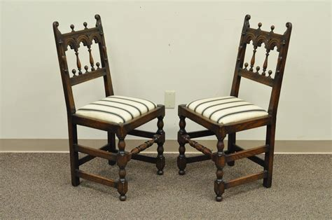 set of eight solid carved oak 1930s jacobean or
