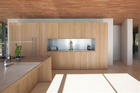 Curved Kitchen Island Designs concrete and glass home with main level wood ceiling