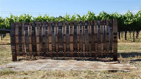 hide   propane tank   fence    barrel