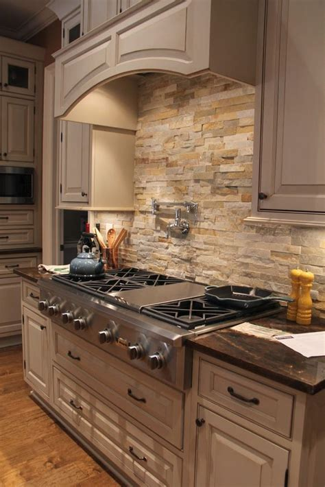 kitchens with stone backsplash 29 cool stone and rock kitchen backsplashes that wow