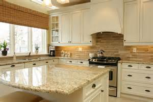 white cabinets santa cecelia granite neutral backsplash