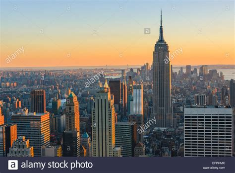 manhattan view manhattan view at sunset from top of the rock at