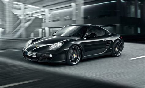 porsche cayman black car and driver