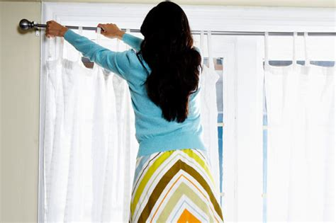 how to put up curtain rods how to choose and hang curtains aol on