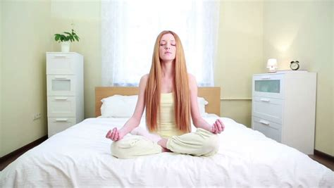 lotus position in bed healthy sitting in pose on bed stock footage