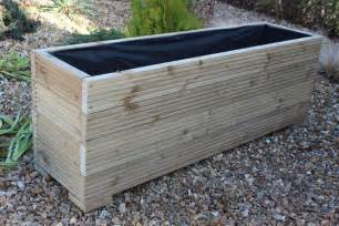 large wooden garden planter trough veg bed plant pot