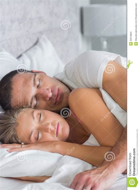 spooning in bed photos cute couple sleeping and spooning in bed stock photos image 32513853