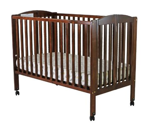 on me size 2 in 1 folding stationary side crib