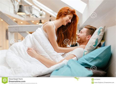 how to romance a woman in bed beautiful couple romance in bed stock photo image 64783003