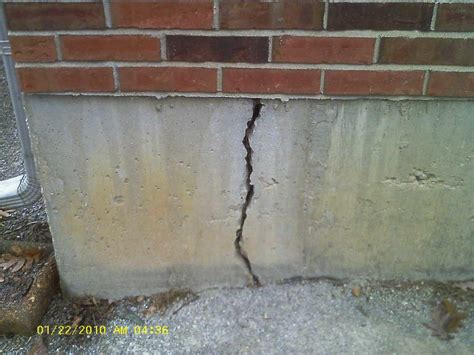 vertical cracks in basement walls foundation settlement in floristell mo