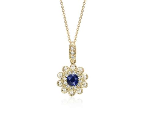 sapphire and cut floral pendant in 18k yellow