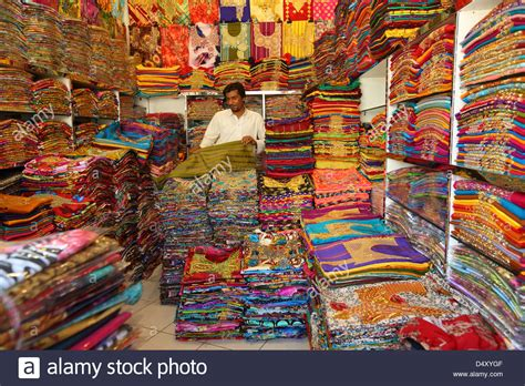 upholstery fabric shops in dubai man folding fabric in textile shop dubai united arab