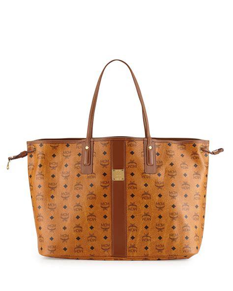 mcm liz reversible large visetos tote bag in brown lyst