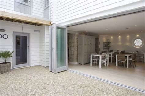 luxury homes st ives bi fold doors from kitchen to gravel courtyard luxury
