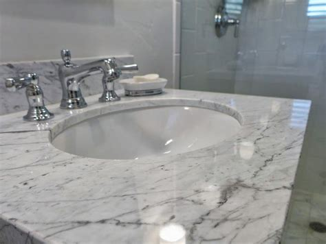 carrara marble bathroom countertops pin by accent interiors on bathrooms by accent interiors