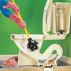 how to fix a clogged toilet the family handyman