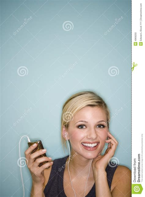 pretty woman mp3 woman listening to mp3 player stock photo image 4969250