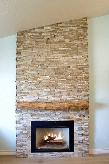 dry stacked stone fireplace  raw edge cypress mantel
