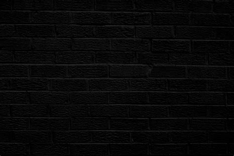 black brick wall black brick wall texture picture free photograph