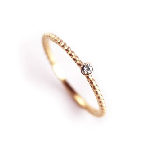 tiny dotty solitaire engagement ring by alison