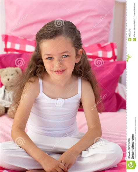 girl sitting on bed little girl sitting on bed stock photography image 11997312