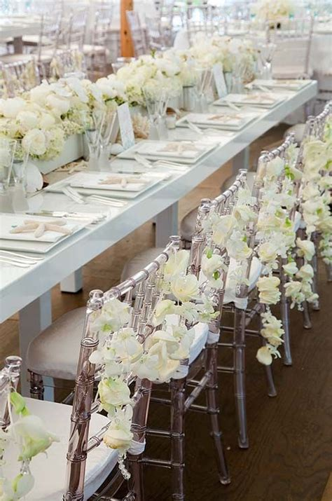 clear chiavari chairs wedding clear chiavari chairs are decorated with garlands of roses