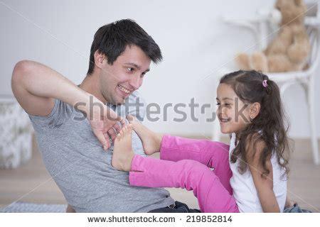 ticklish pug tickle foto immagini royalty free e vettoriali