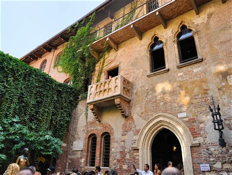 "Verona : Juliet's balcony   We see ""Juliet"" at the balcony"