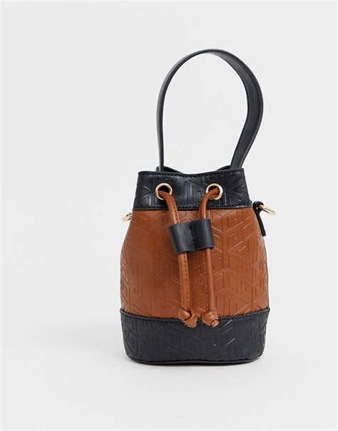 asos design micro bucket  bag  embossed monogram asos