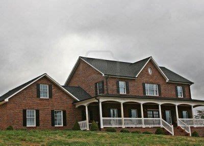 wrap around porch and red brick home pinterest red brick black shutters railings on porch la casa