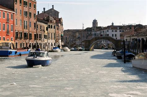 small boat venice frozen venice the lagoon and canals ice over as europe s