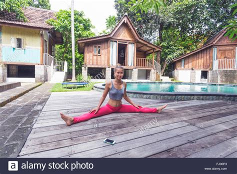 indonesia bali woman practising yoga   poolside