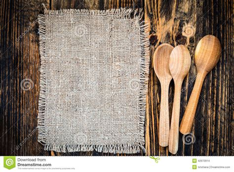 best vintage burlap and rural kitchen utensils on wooden table view