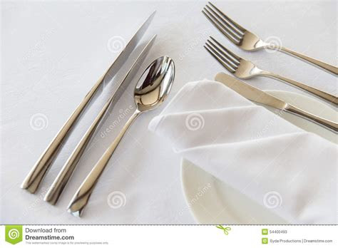 how to set a table with silverware up of cutlery set on table stock photo image 54400493